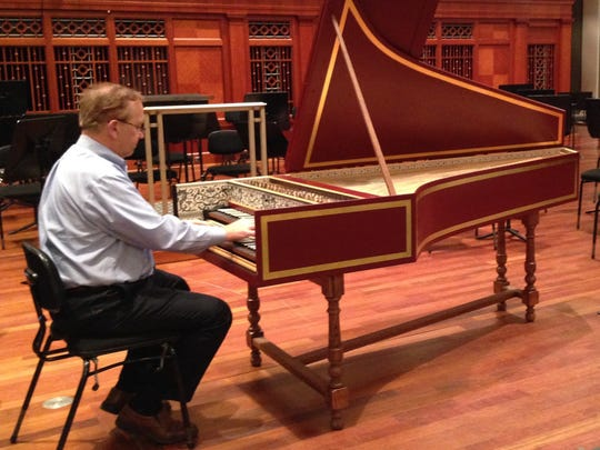 Bob Marler, principal keyboardist for the Nashville Symphony, demonstrates the harpsichord. Bach's Concerto No. 5 features a dazzling harpsichord passage.