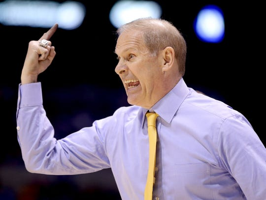 MichiganÕs head coach John Beilein calls a play.Michigan defeated Tennessee 73-71 in the NCAA Division1 Men's Basketball Championship Midwest Regional game Friday, March 28, 2014, evening at Lucas Oil Stadium.