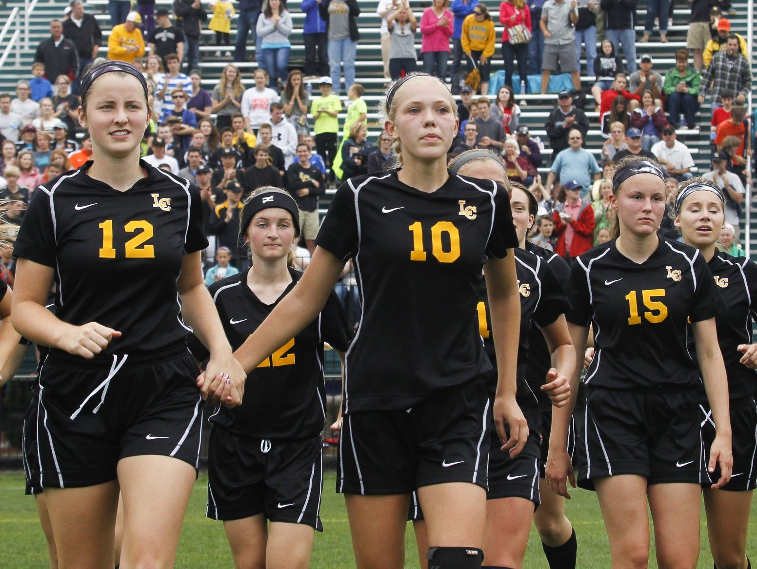 Members of the Lansing Christian soccer team walk off the field after losing to Grandville Calvin 2-1 in the Div. 4 state final last season. The No. 1-ranked Pilgrims are looking to get back to the state tournament on Friday.