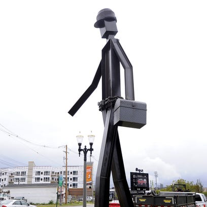 "The structural steel statue ""The Worker"" is freshly"