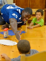 Indianapolis Colts tight end Dwayne Allen joined in the activities with Coburn Place children to promote the Verizon HopeLine Game Day collection.