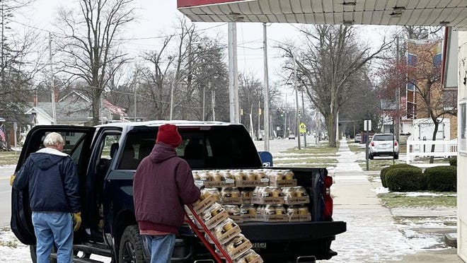 Volunteers unload beans at Bronson Food Pantry.