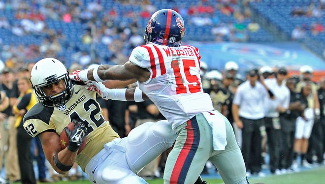 Vanderbilt's Kellen Williams (42) is pushed out of bounds after making a catch by Ole Miss' Kendarius Webster during the fourth quarter at LP Field on Saturday. The Commodores dropped to 0-2 on the season after the 41-3 loss to the Rebels.