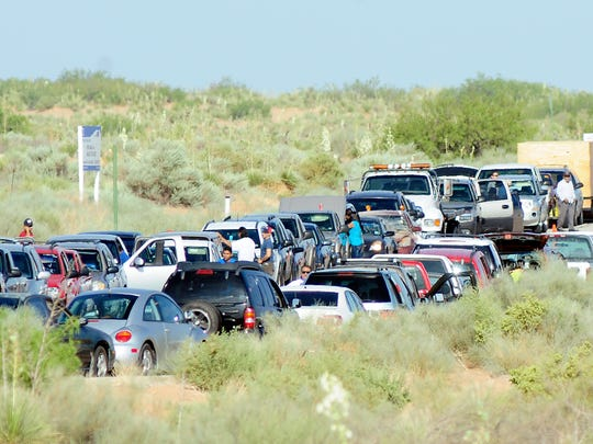 Hundreds of used cars fill Avenida Casas Grande and Saint Francis Ave, near the Santa Teresa Port of Entry on Tuesday, July 15, 2014, before being exported to Mexico.