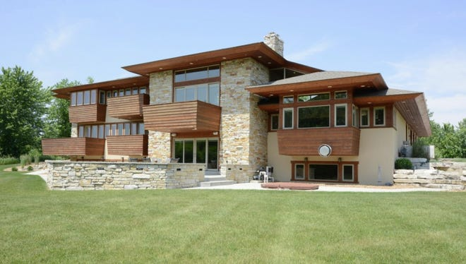 A McDonald-designed home in Raymond may be sold to a Catholic order to house priests-in-training