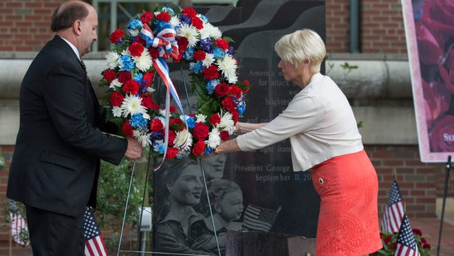 Ocean County Prosecutor Joseph D. Coranato and Freeholder Virinia Haines place wreath at 911 Monument. Ocean County Day of Remembrance ceremony in Toms River as the 15th anniversary of the 9/11 tragedy aproaches.