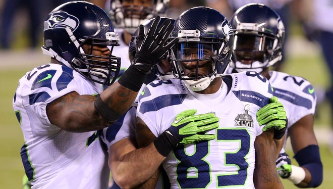 Seattle Seahawks wide receiver Ricardo Lockette (83) celebrates with teammates during the fourth quarter against the Denver Broncos in Super Bowl XLVIII at MetLife Stadium.