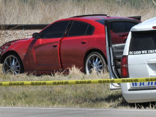 Crime scene tape is used to mark off the area where Anthony Carter was shot and killed by DPS a trooper near East of Vernon after he led multiple law enforcement agencies on a high-speed chase.