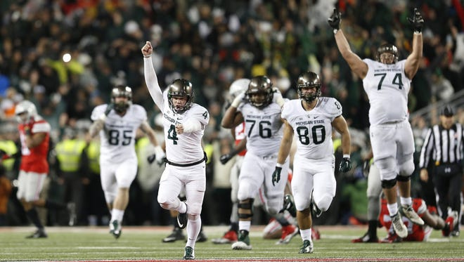 Michigan State kicker Michael Geiger (4) celebrates a 41-yard field goal as time expires during the fourth quarter against Ohio State on Saturday, Nov. 21, 2015, at Ohio Stadium in Columbus, Ohio. Michigan State won, 17-15. (Adam Cairns/Columbus Dispatch/TNS)