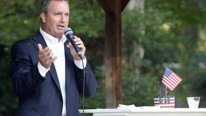 SC Rep. Jeff Duncan speaks to a crowd during a Constituent Picnic and Town Hall meeting at TimbeRock at Historic Hopkins Family Farm in Simpsonville on Tuesday, September 3, 2013.