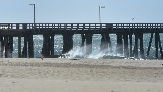Wind carries mist from the tops of breaking waves at Hueneme Beach in October.