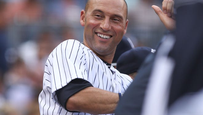 Yankees shortstop Derek Jeter reacts in the dugout after driving in a run with a sacrifice fly during the third inning of Saturday's 6-2 victory over the Kansas City Royals at Yankee Stadium.