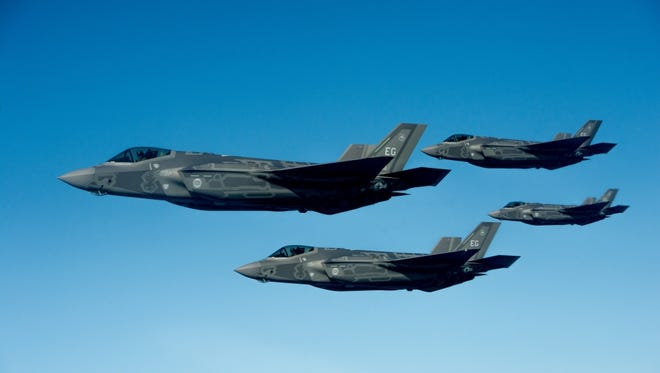 U.S. Air Force F-35A Lightning II Joint Strike Fighters fly off the coast of northwest Florida in this 2013 photo.