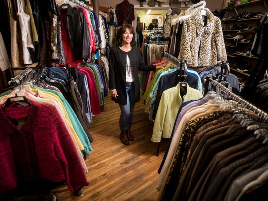Angie Seabury stands in her women's resale store, A
