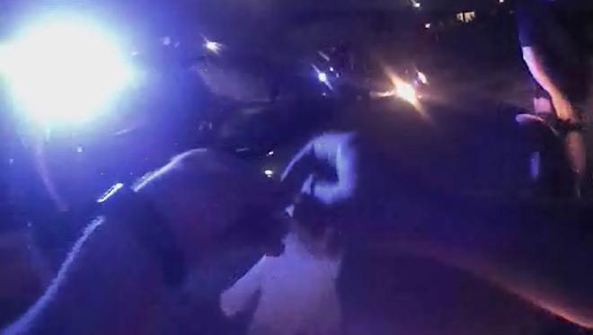 Marksville Police Department Sgt. Kenneth Parnell III puts on gloves in this screen shot from his body camera video.