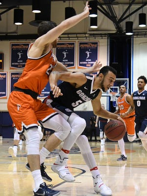 Gonzaga Bulldogs guard Nigel Williams-Goss (5) controls the ball against Pepperdine Waves guard Knox Hellums (21) in the second half of the game at Firestone Fieldhouse. Gonzaga won 71-36.