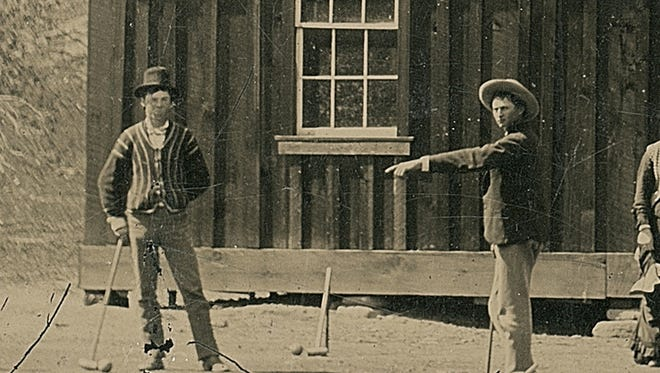 A photo of the Western outlaw Billy the Kid, left, purchased for $2 at a junk shop, could sell for $5 million at auction, according to Kagin's Inc., a rare coin dealer, that confirmed the photo's authenticity.
