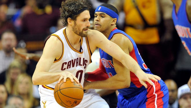 Cleveland Cavaliers forward Kevin Love (0) dribbles against Detroit Pistons forward Tobias Harris (34) in the first quarter at Quicken Loans Arena.