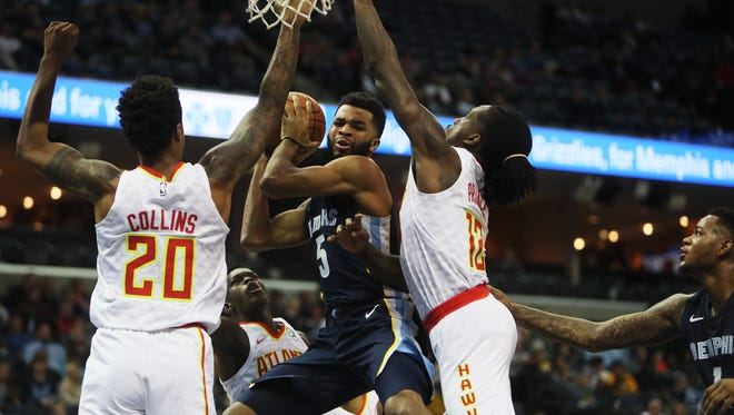 December 15, 2017 - Memphis Grizzlies guard Andrew Harrison (5) is defended by Atlanta Hawks forward/center John Collins (20) and forward Taurean Prince during the second quarter at FedExForum on Friday.