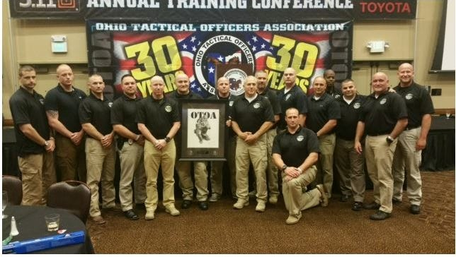 The Mansfield Police Department SWAT members were honored in Sandusky recently by the Ohio Tactical Officers Association for putting their lives in the line of fire at a standoff on Randall Road 2015.