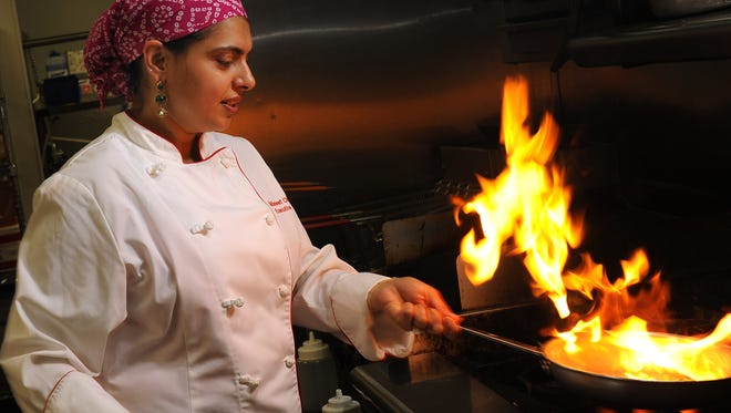 Maneet Chauhan, executive chef of Chauhan Ale and Masala House in Nashville, flames up a dish.