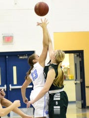 Kayla Anderson (13) of Boone County and Mariah Frommeyer of Bishop Brossart tip the game into action in 2017.