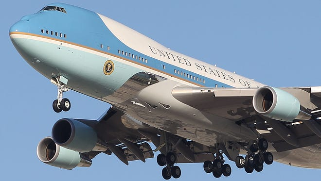 Air Force One lands at Palm Springs International Airport on Friday, June 13, 2014.