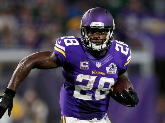 FILE - In this Sept. 18, 2016, file photo, Minnesota Vikings running back Adrian Peterson carries the ball during the first half of an NFL football game against the Green Bay Packers, in Minneapolis. Peterson is returning to practice this week for the Vikings for the first time since tearing the meniscus in his right knee in September. Coach Mike Zimmer says he expects Peterson to practice all week. He is not sure if his star running back will be available to play the Indianapolis Colts this weekend. (AP Photo/Andy Clayton-King, File)