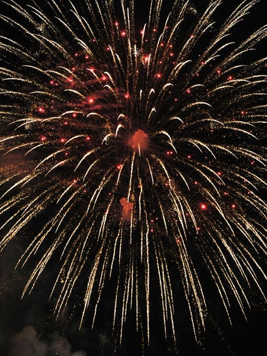 Fireworks light up the sky Wednesday night as part of the Sertoma Fourth of July celebration at Seville Square.