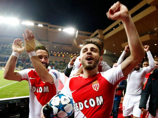 Bernardo Silva of AS Monaco celebrates a win over Manchester