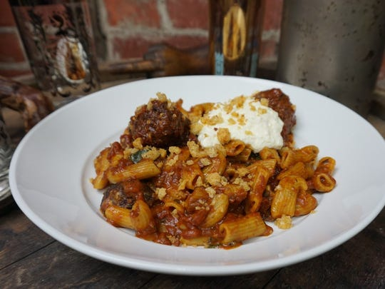 "Rigatoni with chef Lane Milburn's ""Sunday sauce"" and"