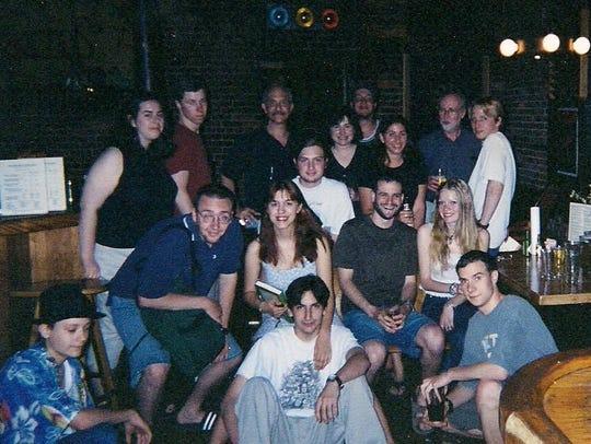 Sydney Schanberg, back, second from right, celebrates