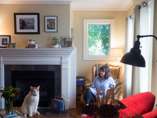 """Casey Fox sits in what they call """"the nook"""" in the"""