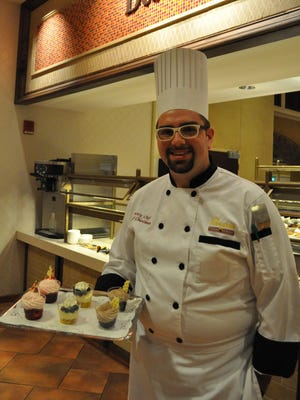Jacob Churchman holds a tray of parfait cups, one of the new items he has added to Paragon Casino Resort's dessert selection.