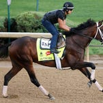 Outwork gets in a gallop at Churchill Downs.