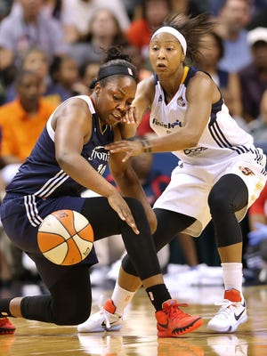 Indiana Fever guard Briann January and Connecticut guard Chelsea Gray battle for a loose ball in the second half of the game at Bankers Life Fieldhouse on Sunday, August 2, 2015. The Fever defeated Connecticut 83-70.