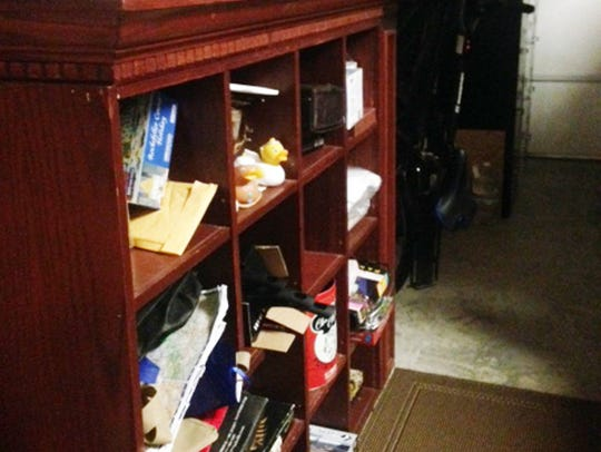 Karen Krieger had the simplest and cheapest  idea of all: just use an old entertainment center, with or without doors, in your garage for storage.