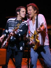 Bruce Springsteen, right, and Nils Lofgren perform together in 2004. They and the E Street Band will perform in the area on Jan. 31 at Prudential Center, Newark; March 28 at Madison Square Garden, New York City; and April 23 and 25, Barclays Center, Brooklyn.