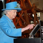 The Queen tweets at the Science Museum on Oct. 24, 2014 in London.