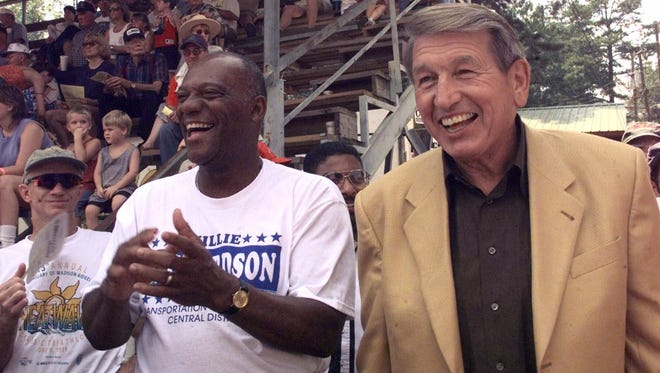NFL Hall of Fame quarterback Johnny Unitas, right, and former Baltimore Colts teammate Willie Richardson, who died Feb. 8, share a joke while watching the harness racing at the Neshoba County Fair in Philadelphia, Miss. in 1999.