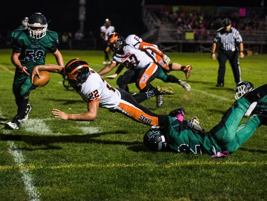 Hanover's Justin Barnes dives for the touchdown Friday