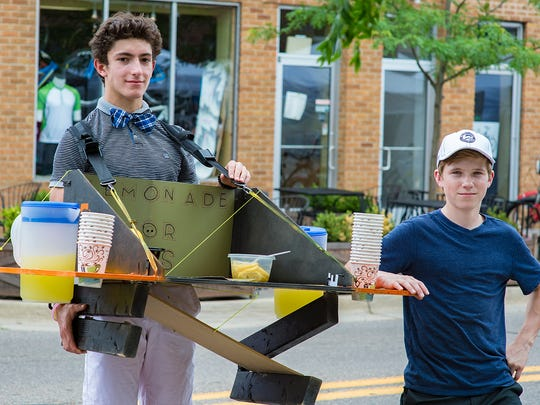 Lemonade vendors Nikko Wood and Demetri Zervos students at Northville high school and their custom designed portable lemonade stand  provided a cold beverage option to thirsty artists and visitors.