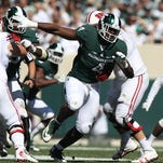 Malik McDowell can be dominant 'when he turns the motor on,' Mark Dantonio says