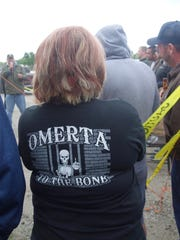 "A Boone supporter wears ""Omerta"" t-shirt at the fundraiser. Omerta is Italian for ""code of silence,"" which Johnny Boone has tattooed on his back."