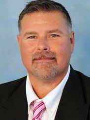 McMurry football coach Lance Hinson