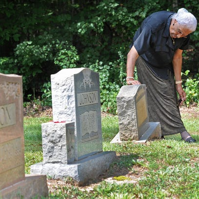 The Rev. Dr. Flora Johnson-Winestock visits the grave