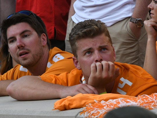 A Tennessee fan looks dejected during the Tennessee
