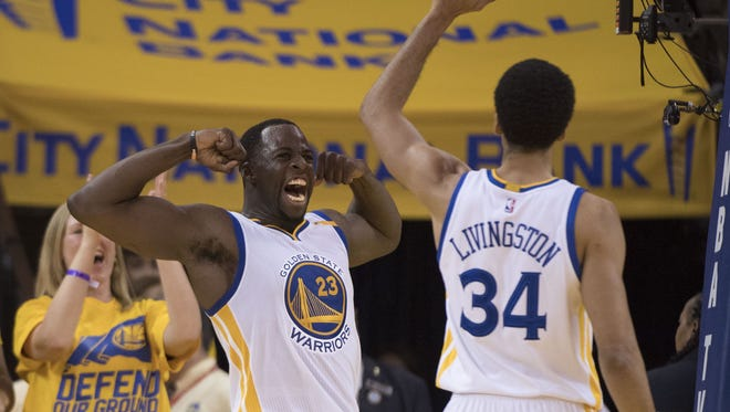 Golden State Warriors forward Draymond Green (23) celebrates with guard Shaun Livingston (34) against the Portland Trail Blazers during the fourth quarter in game one of the first round of the 2017 NBA Playoffs at Oracle Arena.