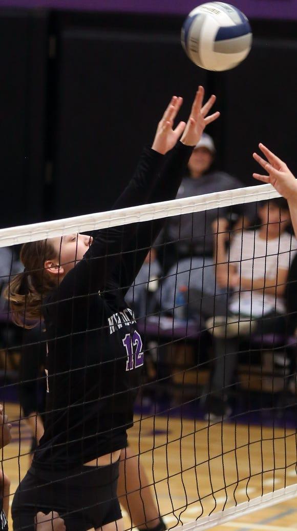 New Rochelle's Anna Gussenhoven(12) returns the ball