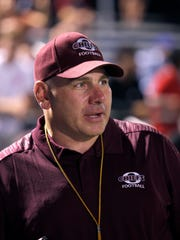 Okemos coach Mike Krumm is shown during a midnight